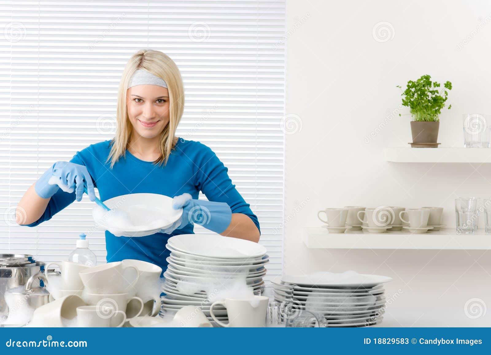 modern kitchen - happy woman washing dishes stock photos - image