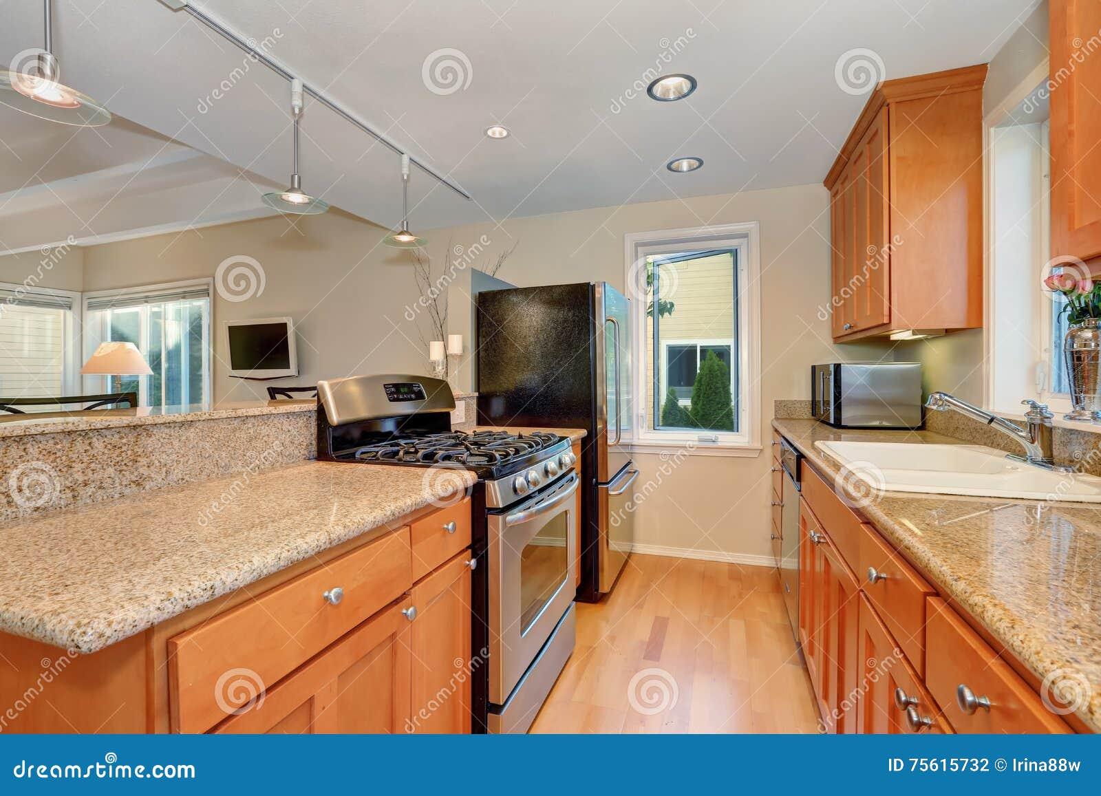 Modern Kitchen Interior With Granite Counter Tops Stock Photo