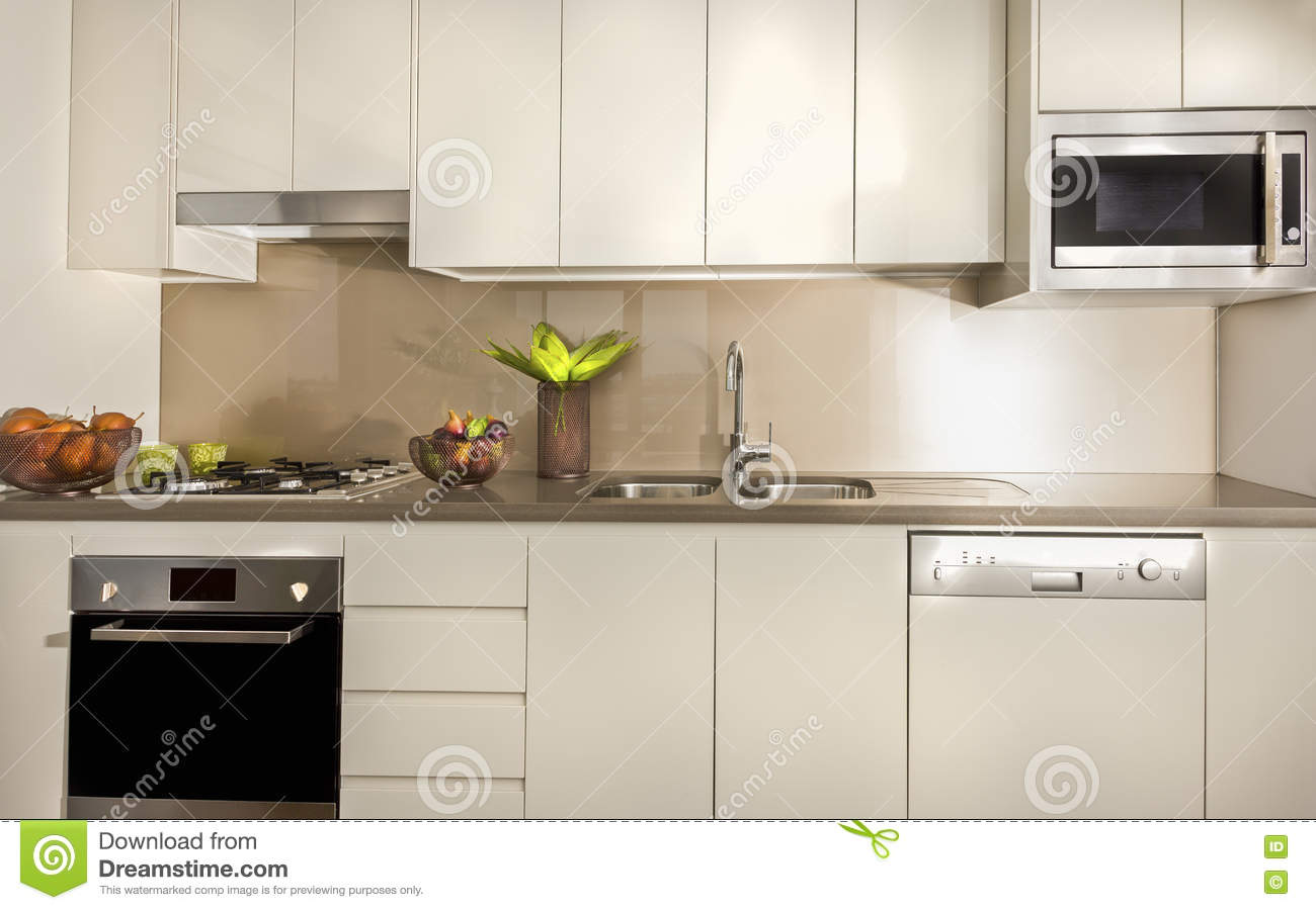 Modern kitchen with pantry cupboards and counter top stock for Kitchen top cupboards