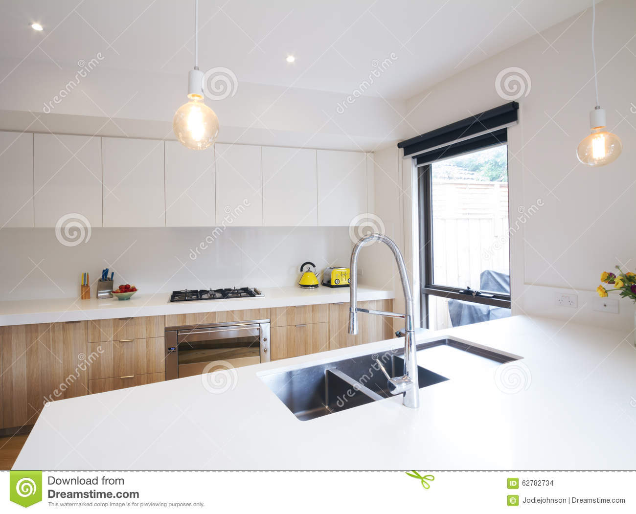 Modern Kitchen With Pendant Lighting And Sunken Sink Stock ...