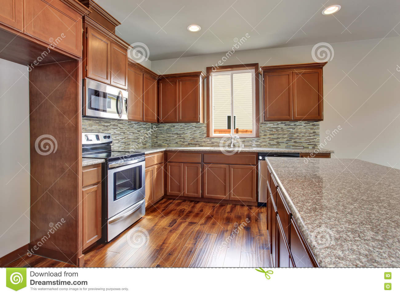 Modern Kitchen Room With Brown Cabinets Granite Counter Tops And