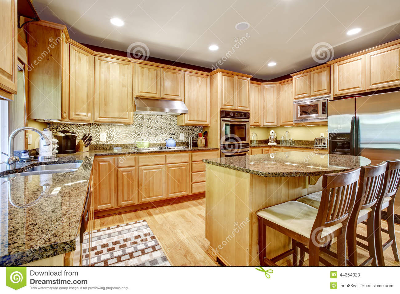 Light brown kitchen room with granite tops and kitchen island Tile