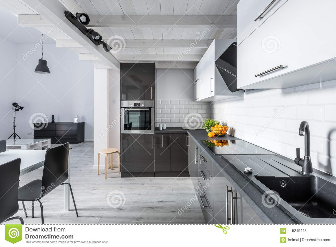 Modern kitchen with rustic ceiling
