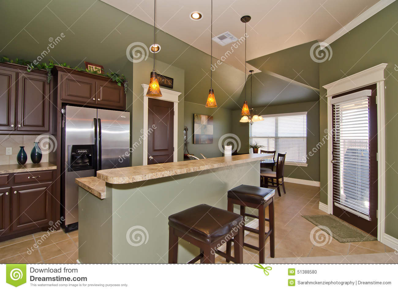 Modern kitchen with sage green walls stock photo image for Brushed sage kitchen cabinets