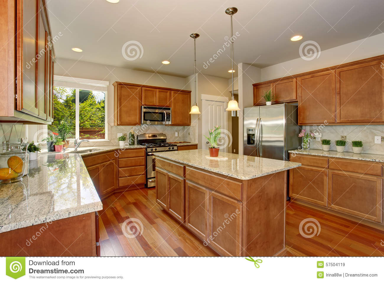 Modern kitchen with simple wood cabinets stock photo for Simple modern kitchen cabinets