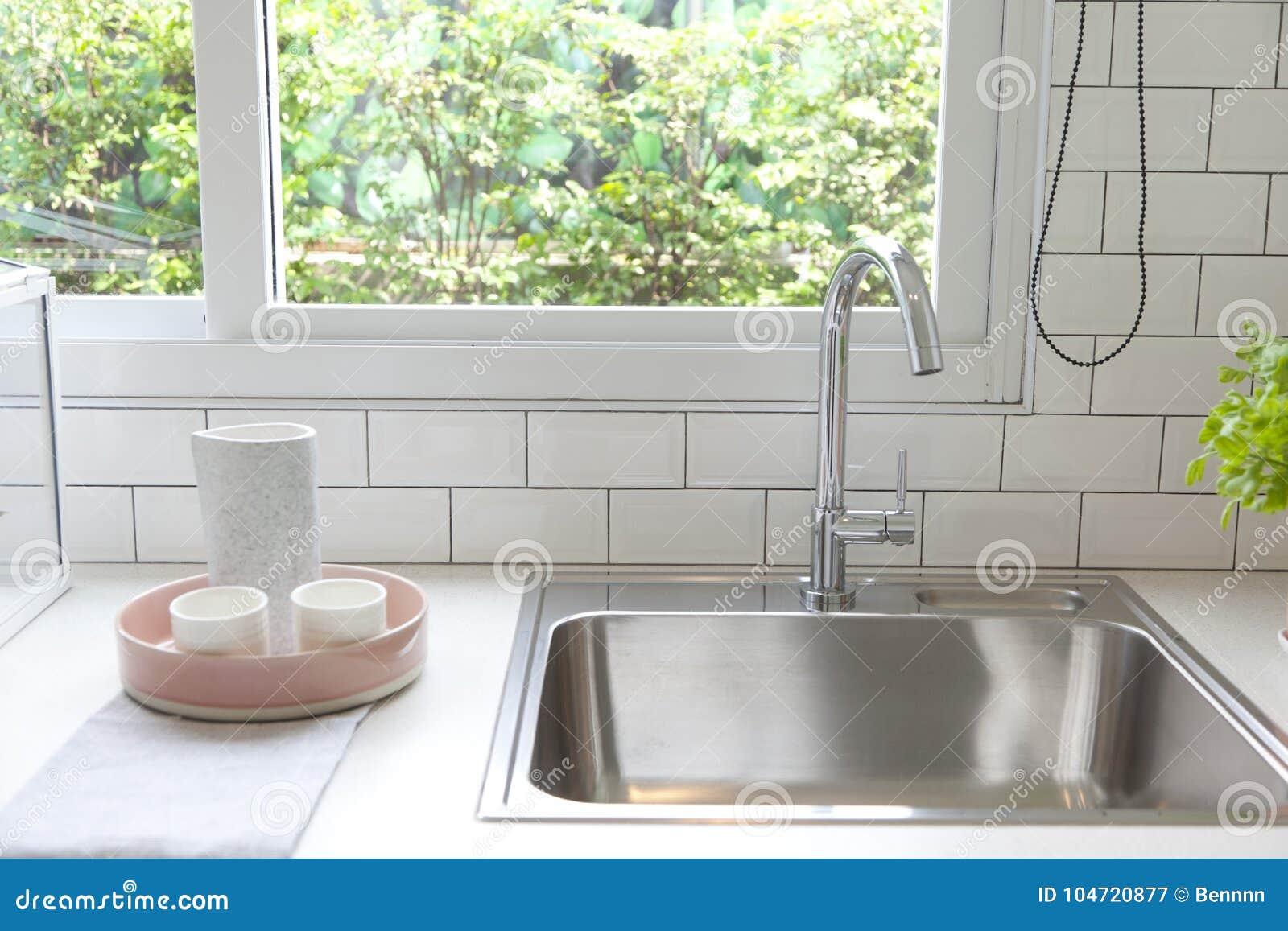 Modern kitchen with white worktop sink