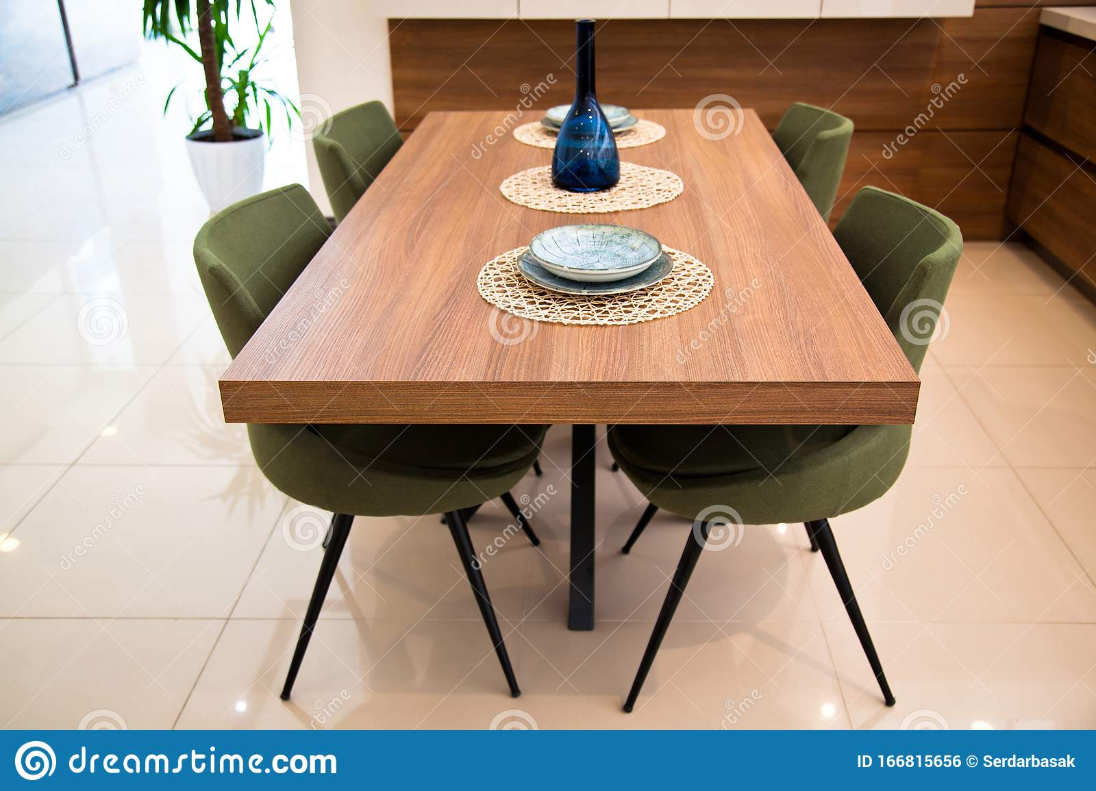 Modern Kitchen, Wooden Walnut Dining Table and Green Chairs Stock ...