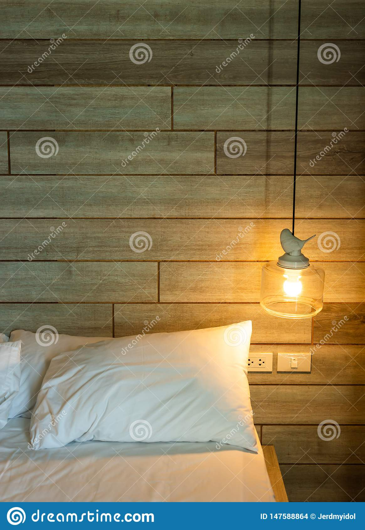 Modern lamp on  the white bed