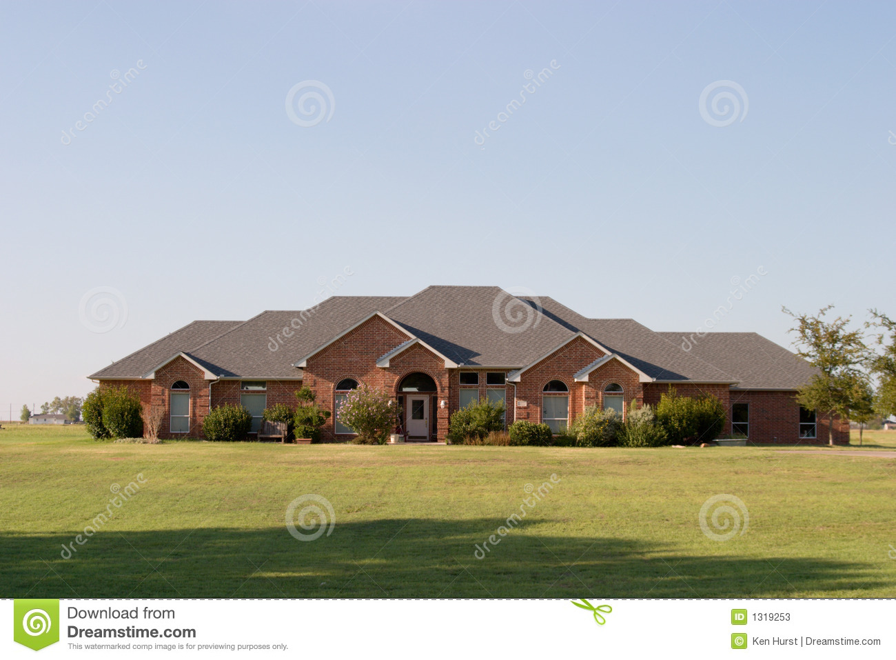 Modern large ranch style brick house stock photos image for Large ranch house plans