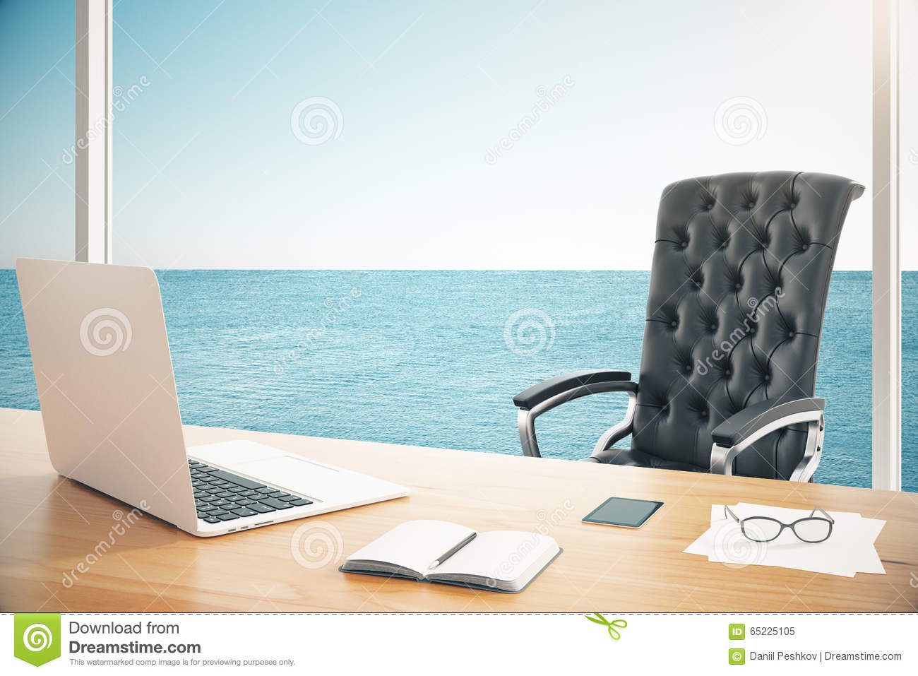 Modern leather chair with wooden table with laptop in room with