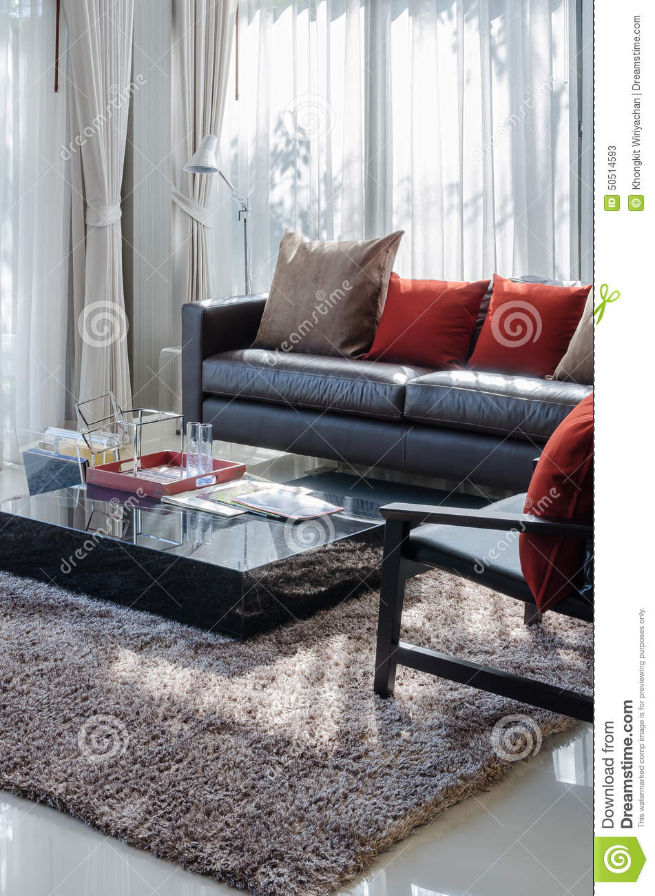 Modern Living Room With Brown Sofa And Red Pillows
