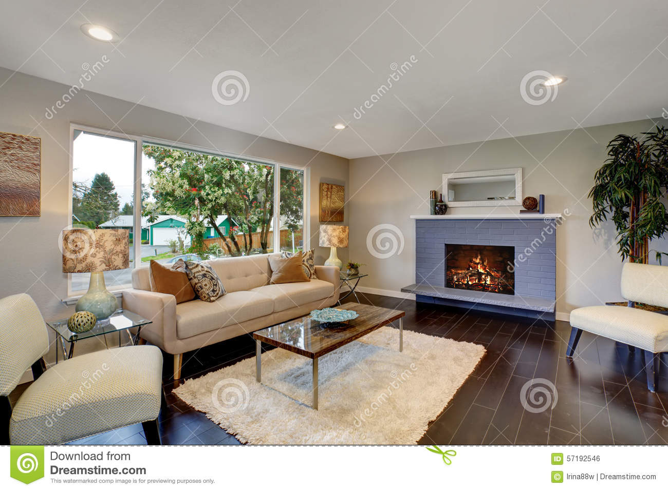 Modern living room with dark hardwood floor stock photo for Photo salon moderne