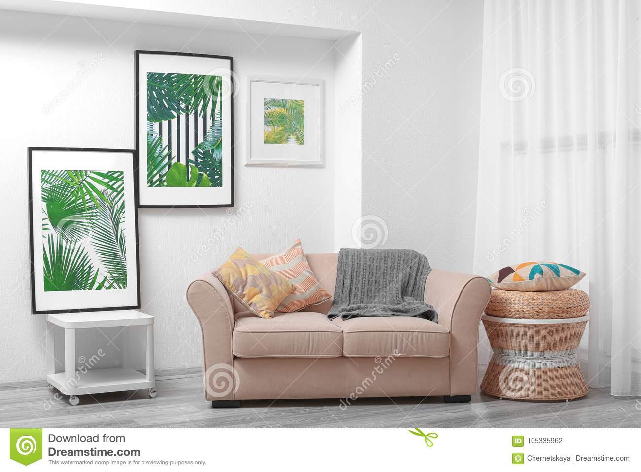 Modern Living Room Design With Framed Pictures Of Leaves Stock Photo ...