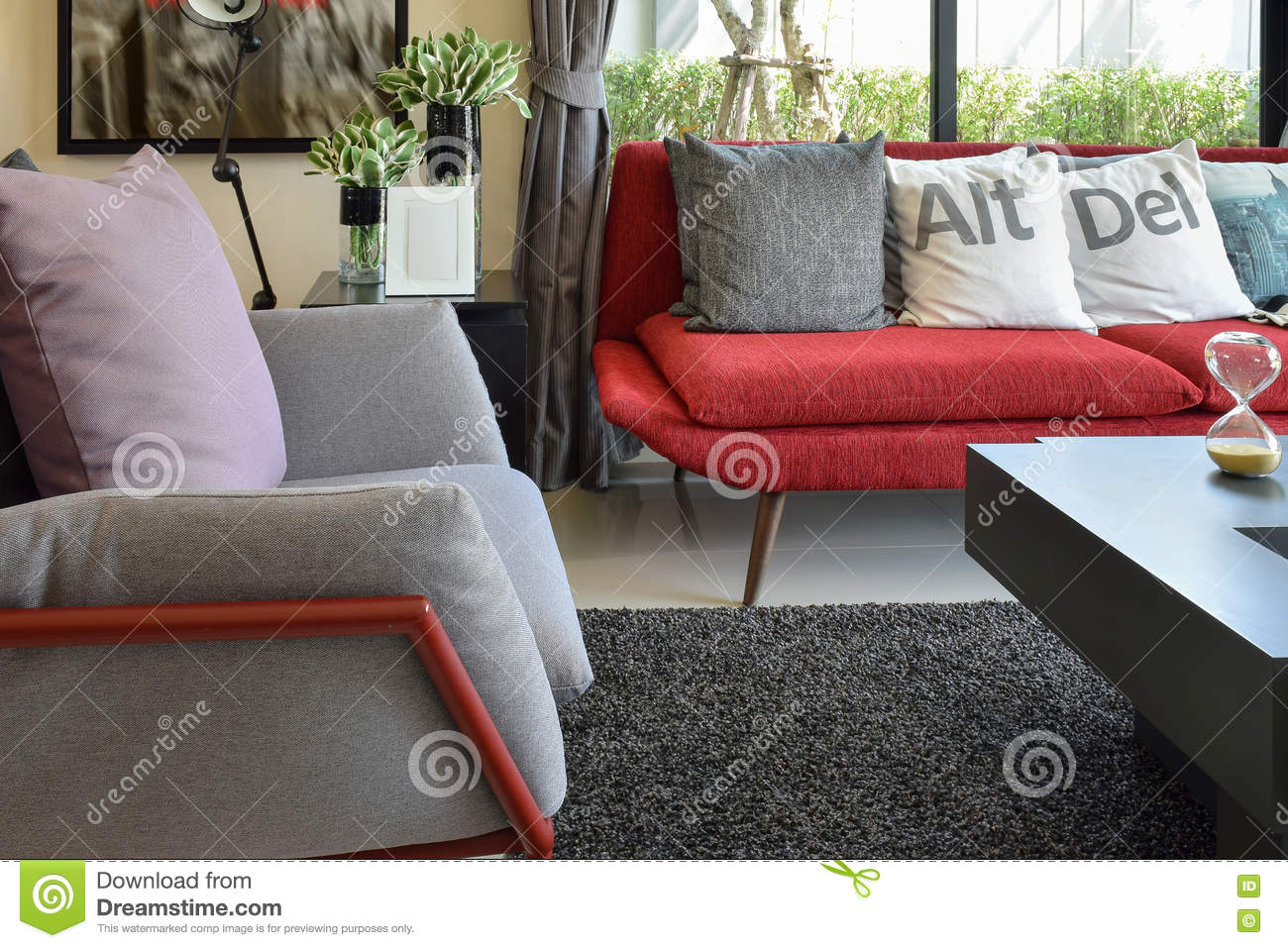 Modern living room design with pillows on the red sofa and for Designer throws for sofas