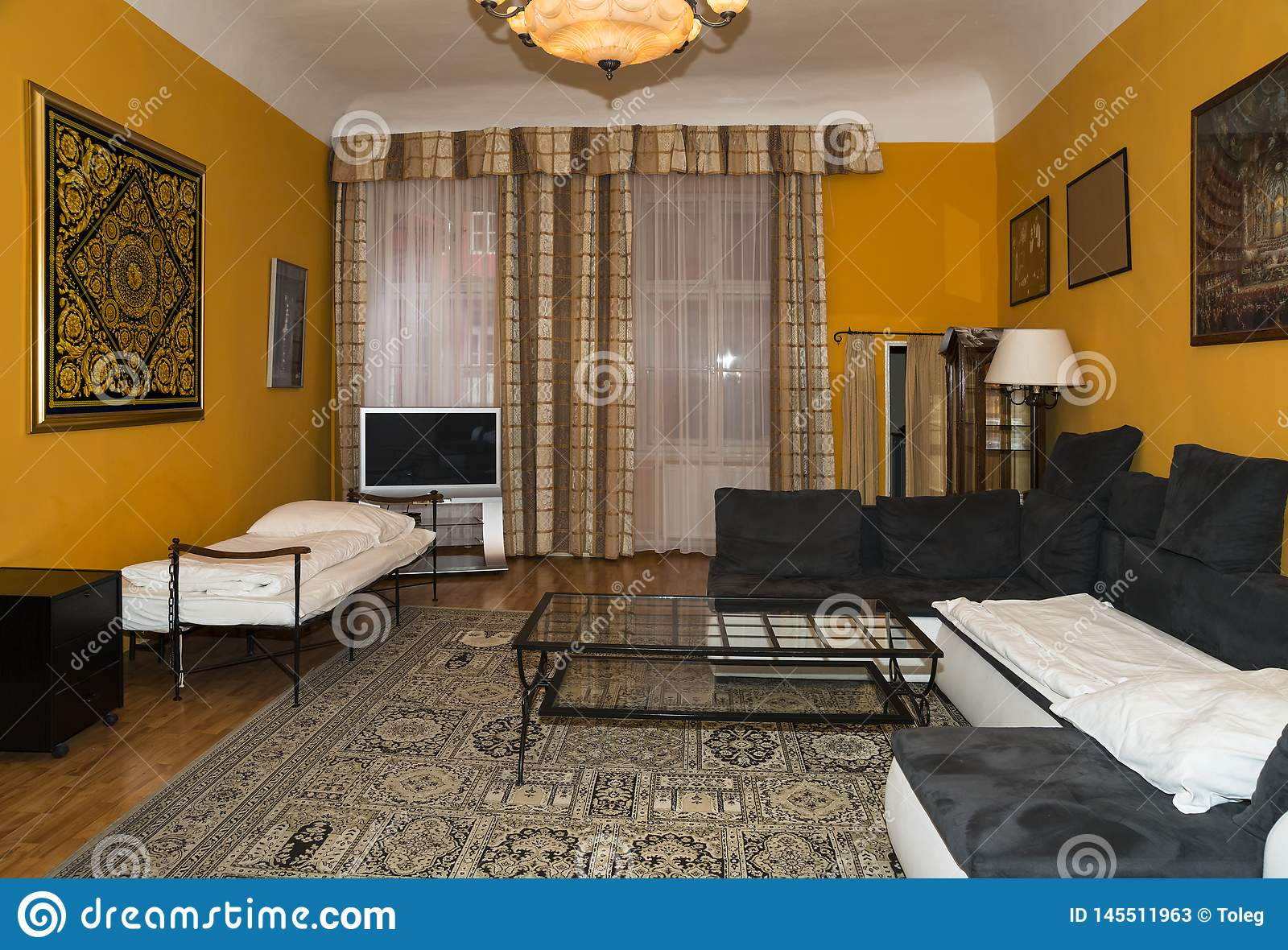 Picture of: Modern Living Room Design With Yellow Walls Carpet On The Floor And Curtains On The Windows Editorial Stock Photo Image Of Rest Soft 145511963