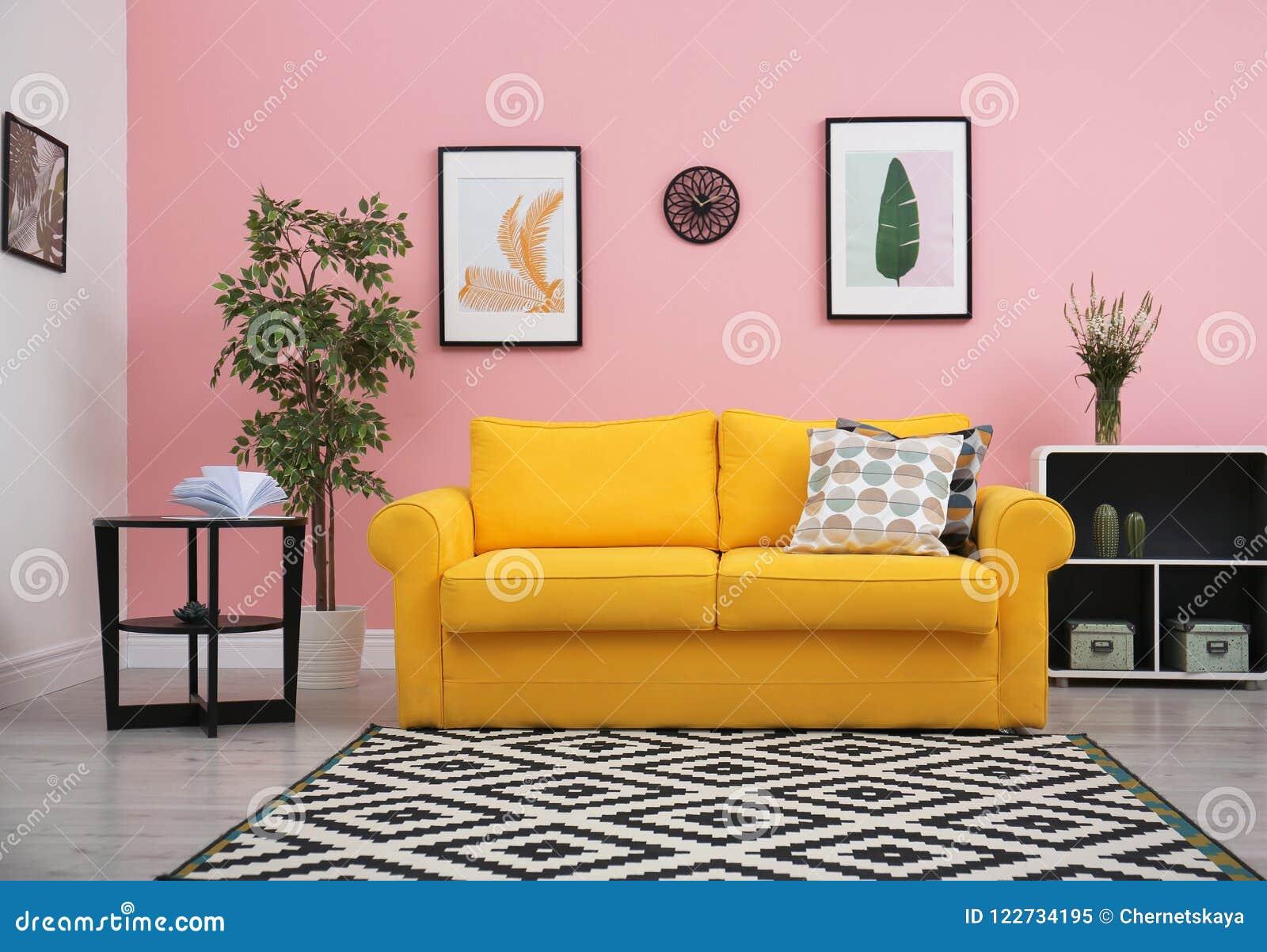 modern living room interior with comfortable yellow sofa