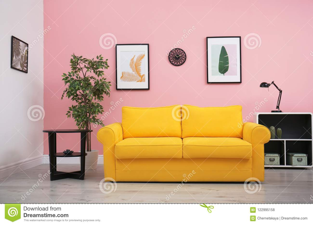Modern Living Room Interior With Comfortable Yellow Sofa Stock Photo ...