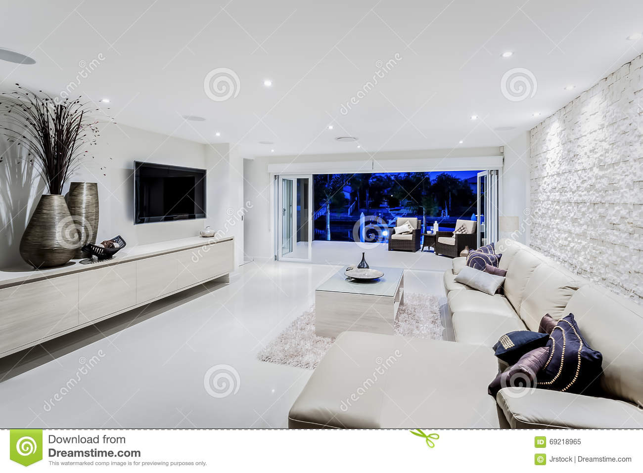 Modern living room at night with sofas and pillows