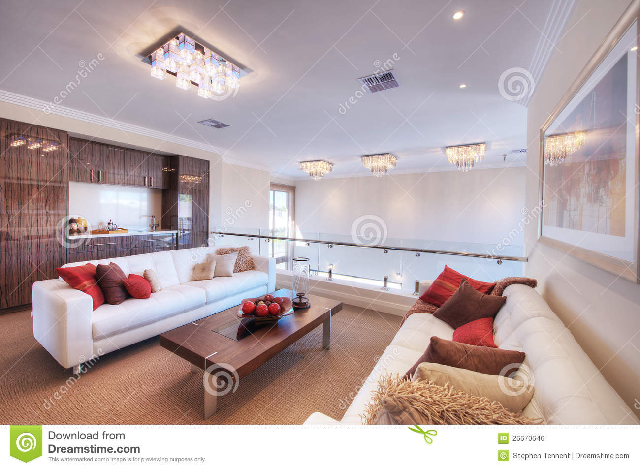 Large lounge living room with white leather sofa and chairs