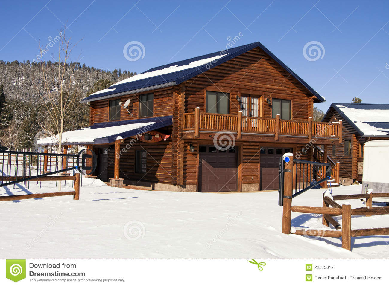 Download Modern Log Cabin Home In The Winter Woods Stock Photo