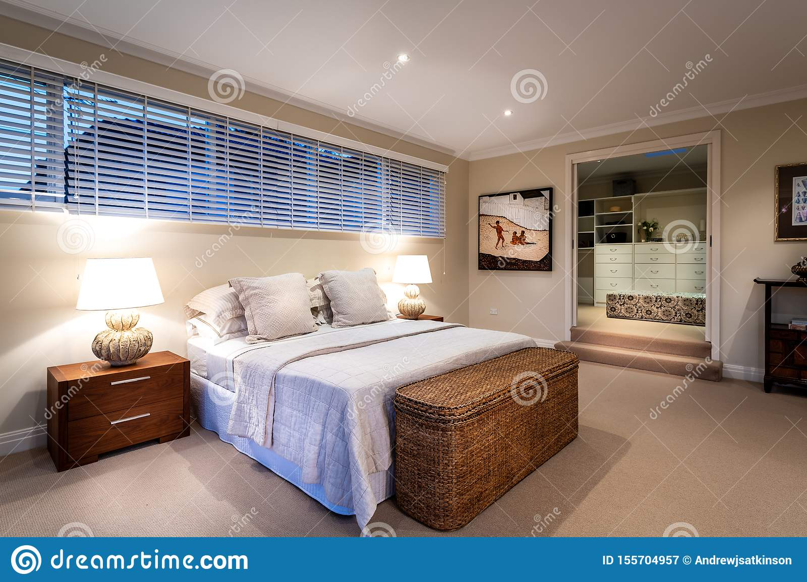 Modern Luxury Master Bed Room With Bed Side Tables Lamps Down Lights And Walk In Robe Real Estate Editorial Photography Image Of Bedroom Indoors 155704957