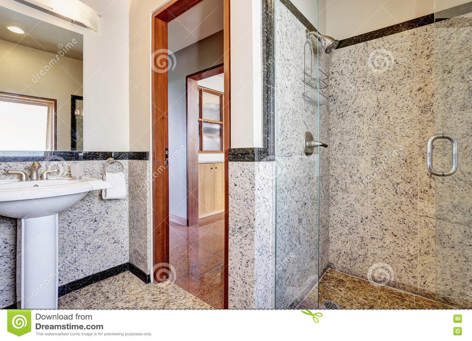 Modern marble bathroom with walk-in shower.