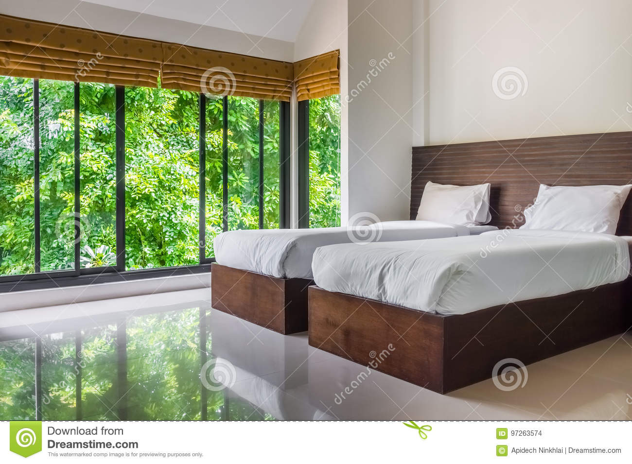 Modern Master Bedroom With Twin Beds And Wide Glass Windows Stock