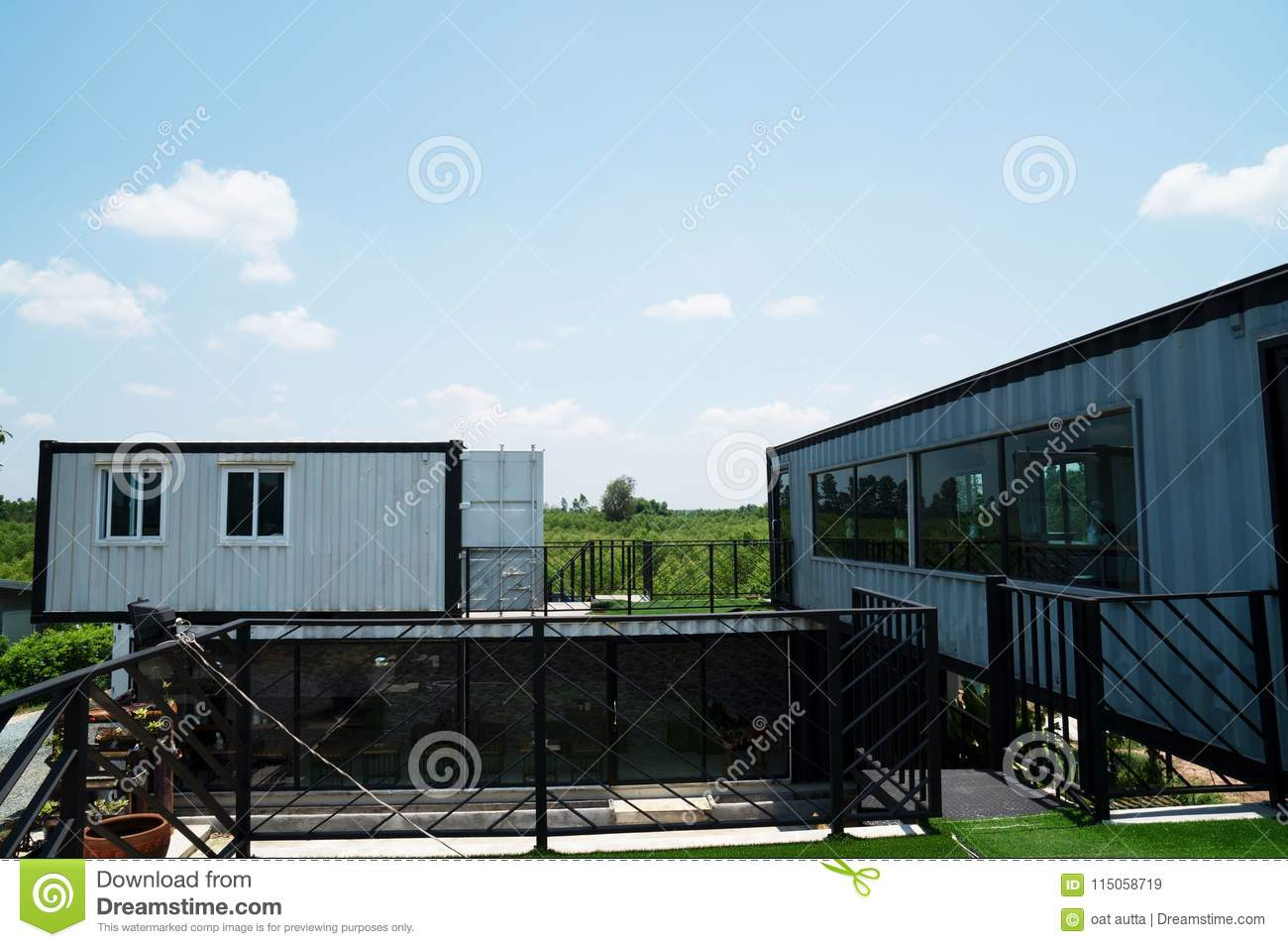 Modern metal building made from shipping house containers and blue sky background