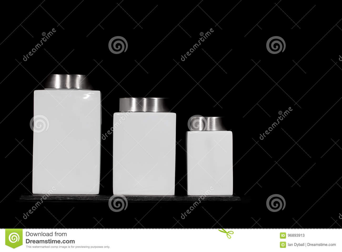 Modern minimalist kitchen storage jars square white ceramic canisters in modern design set of three sizes on slate coaster against black background with