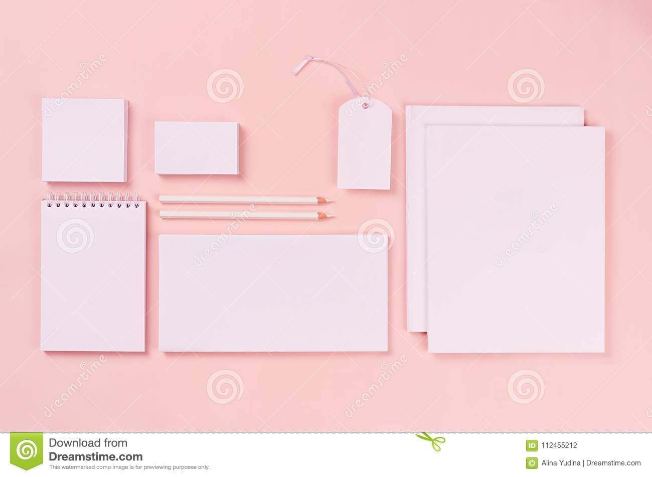 modern minimalistic workspace with white blank stationery on soft