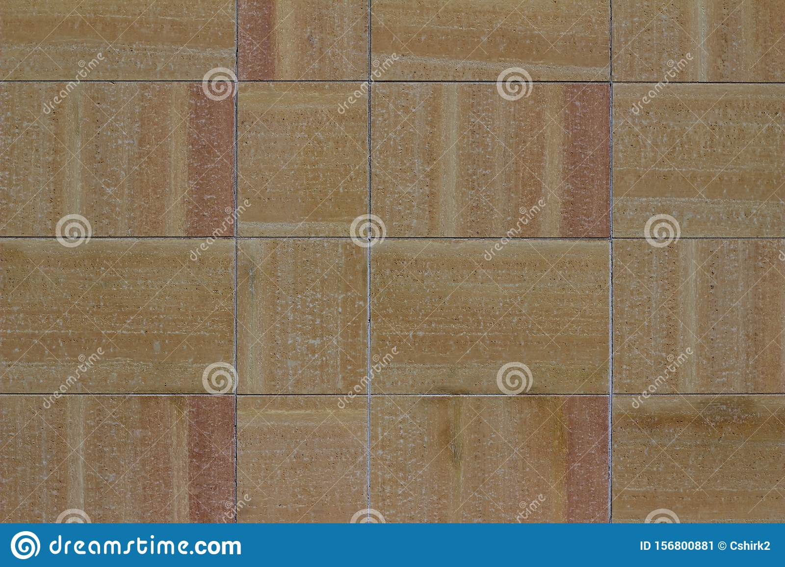 Modern multi-hued stone tile wall texture in shades of beige, tan, and pink