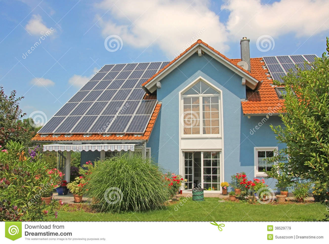 Modern new built house and garden rooftop with solar for Blue modern house