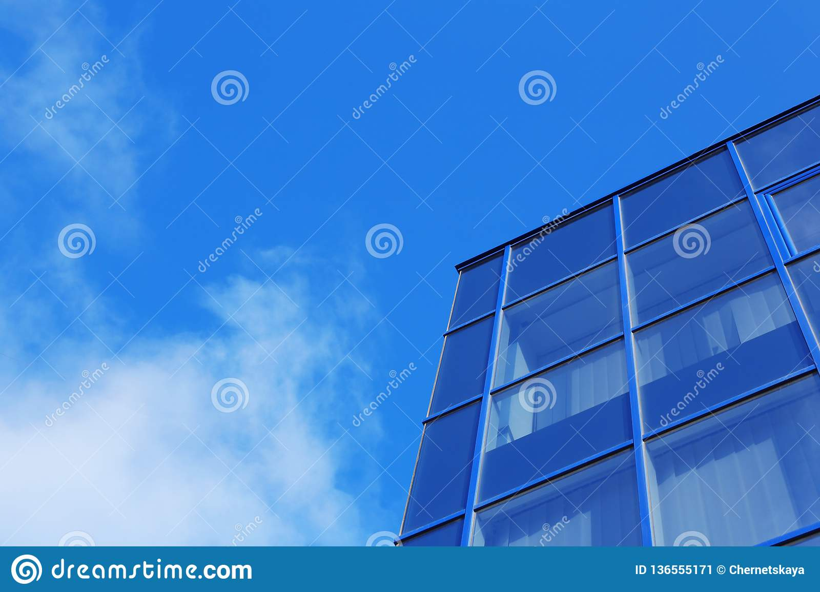 Modern office building with tinted windows against sky