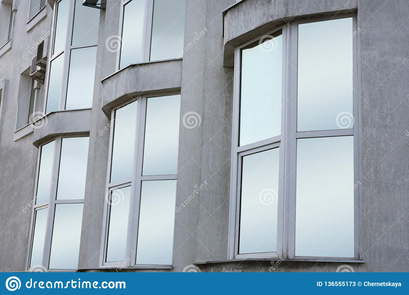 Modern office building with tinted windows. Urban