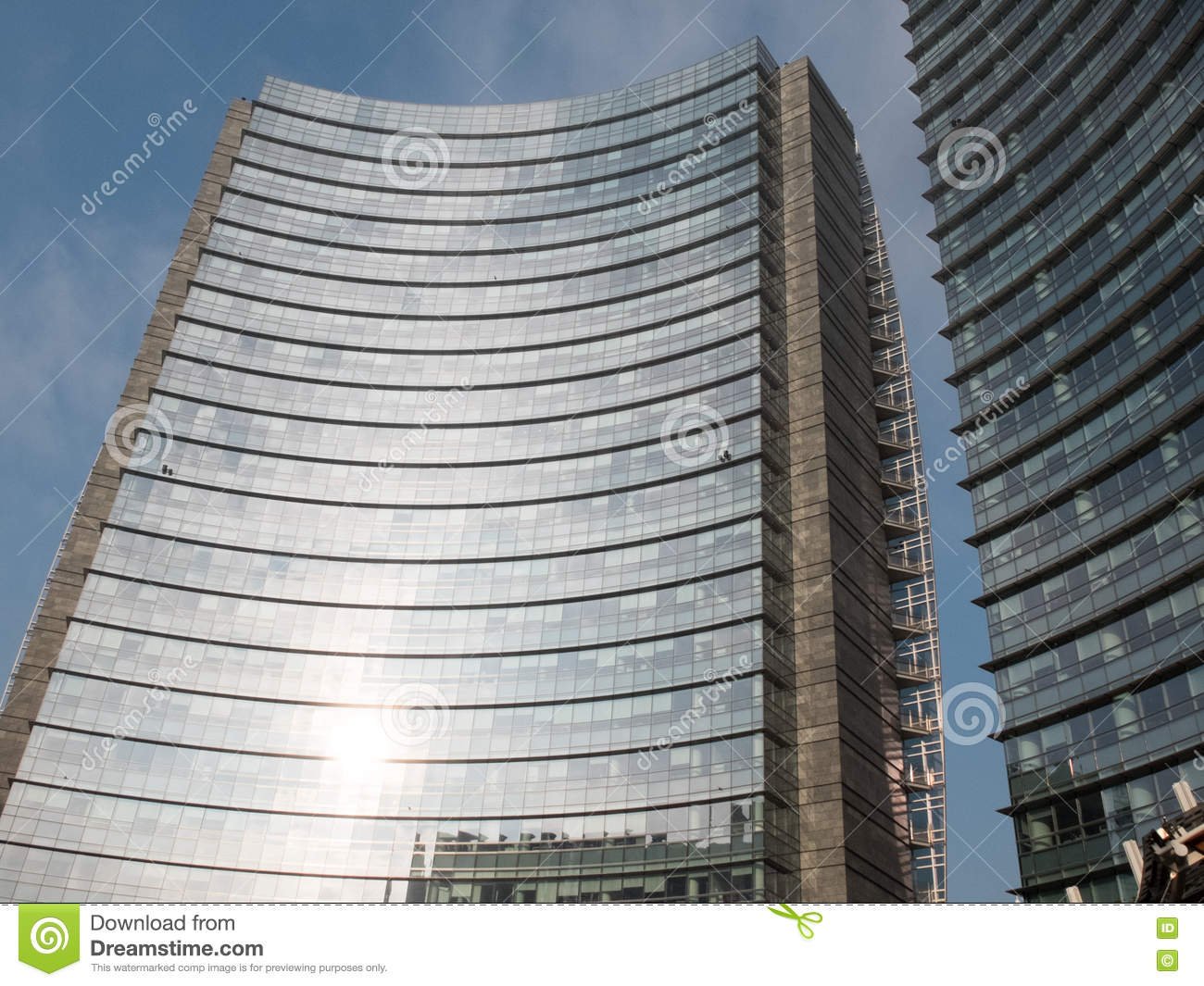 Modern office high rise with curved facade stock photo for Modern high rise building design