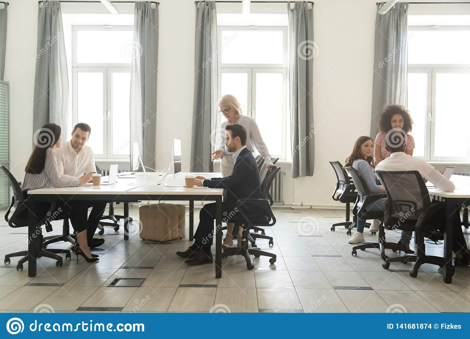 Modern office interior with business team people working on computers