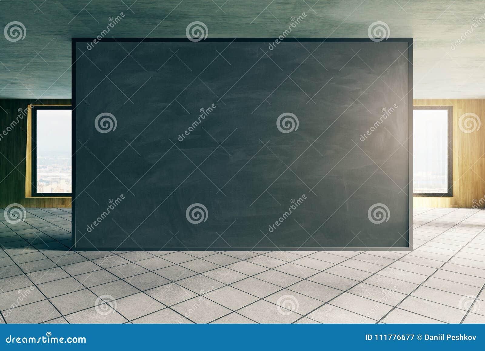 Modern office with empty blackboard