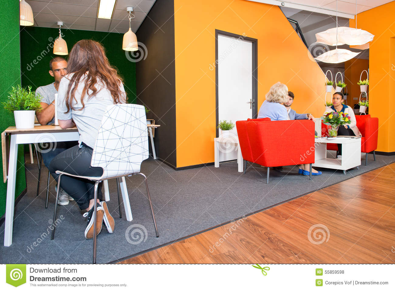 Office Waiting Room With Two Comfortable Dark Leather Armchairs Near A Round Coffee Table