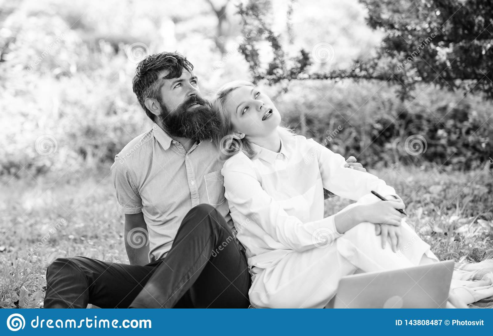 Modern online business. Couple youth spend leisure outdoors working with laptop. How to balance freelance and family