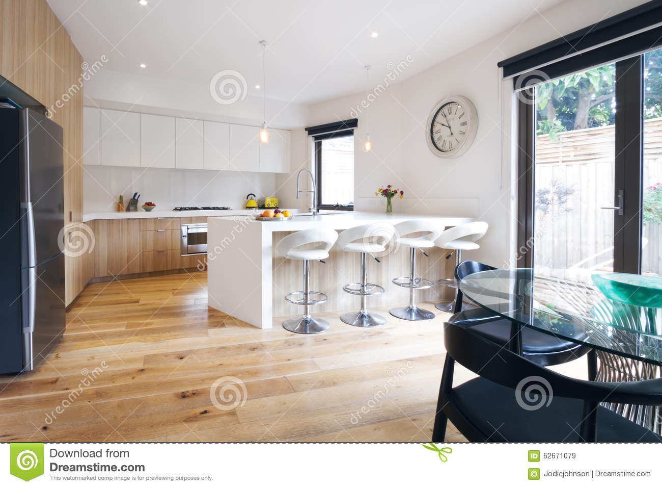 modern open plan kitchen with island bench stock image