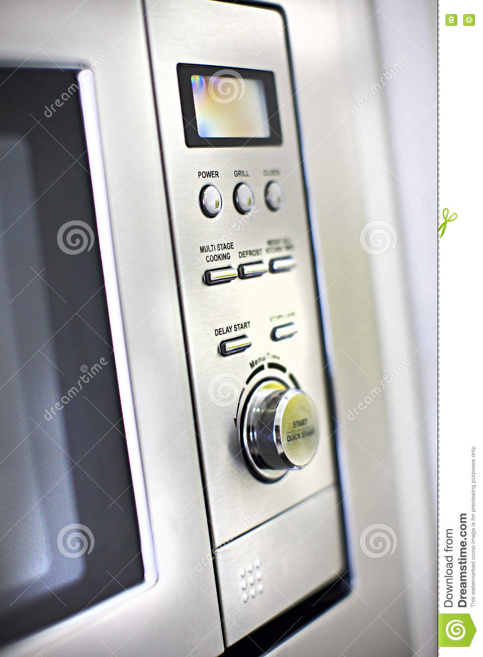 Modern oven control panel close up with buttons and knob