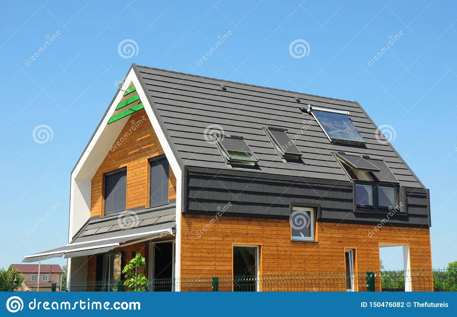 Modern Passive House Exterior. Modern energy efficiency house with skylight windows and solar panels on the roof top