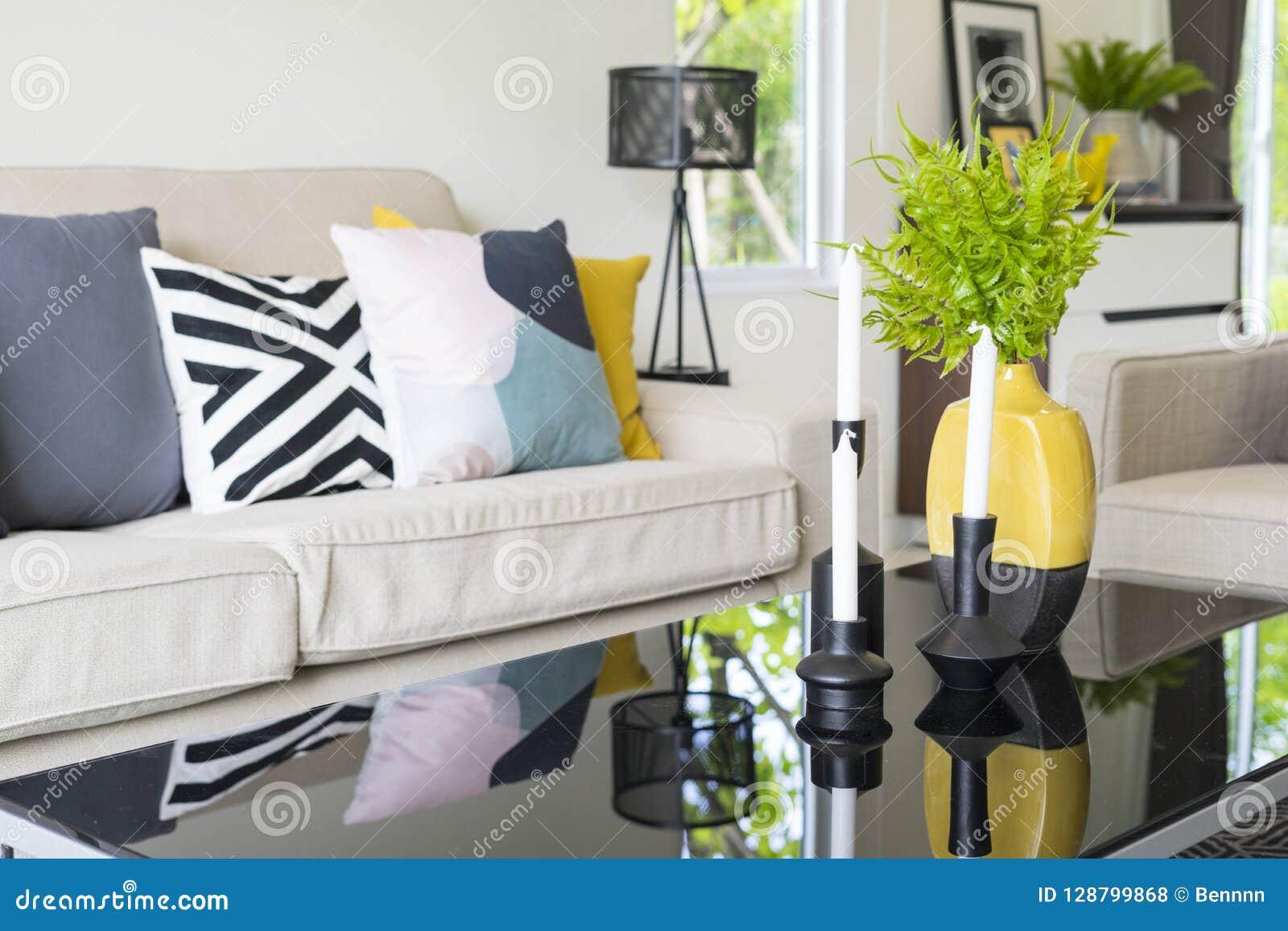 Modern Pattern Blue And Yellow Cushion On Grey Sofa Stock
