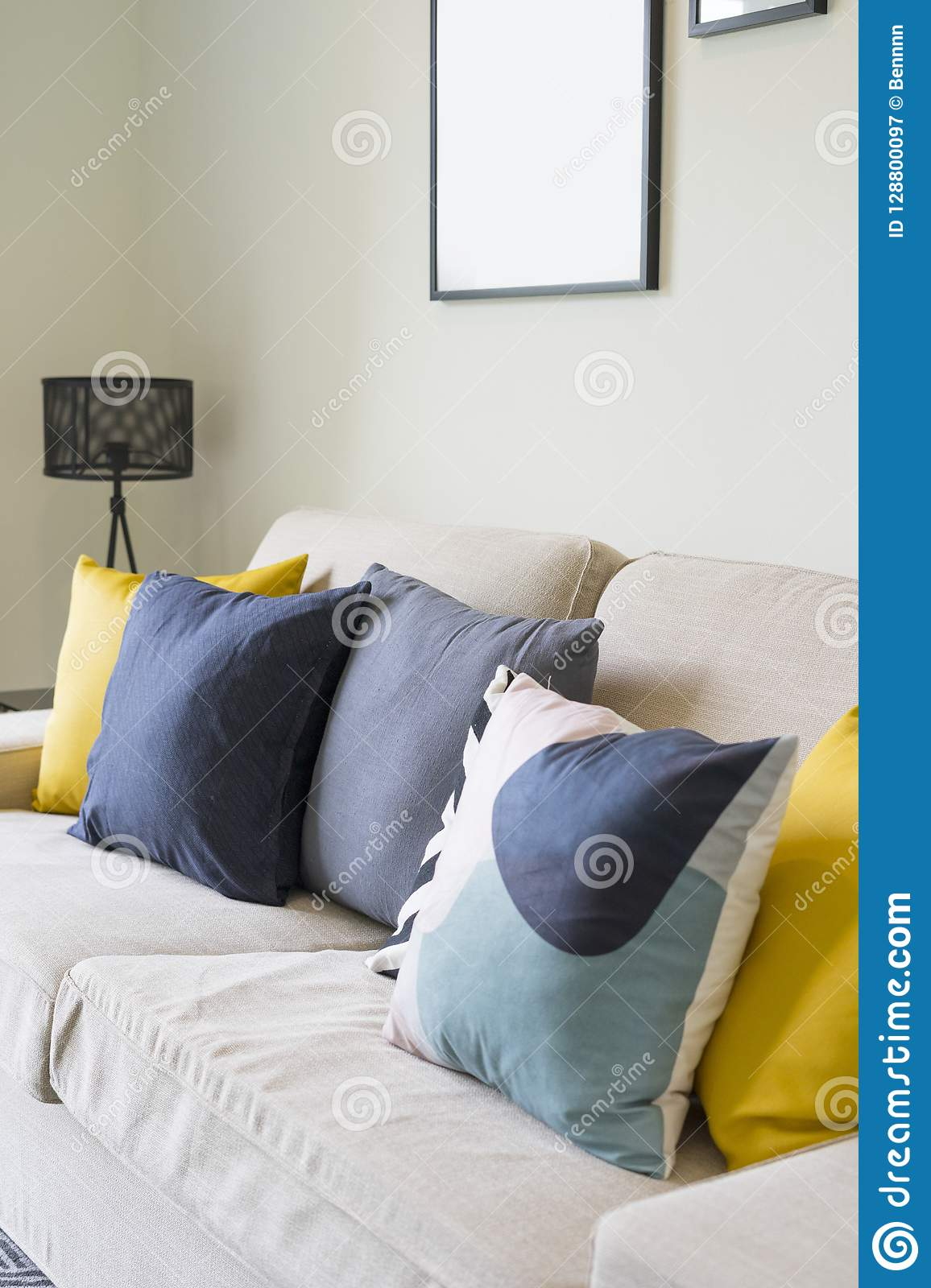 Modern Pattern Blue And Yellow Cushion On Grey Sofa Stock Image