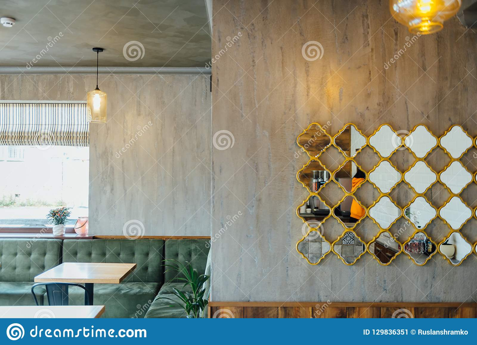 Modern pizzeria interior with gray plaster on the walls