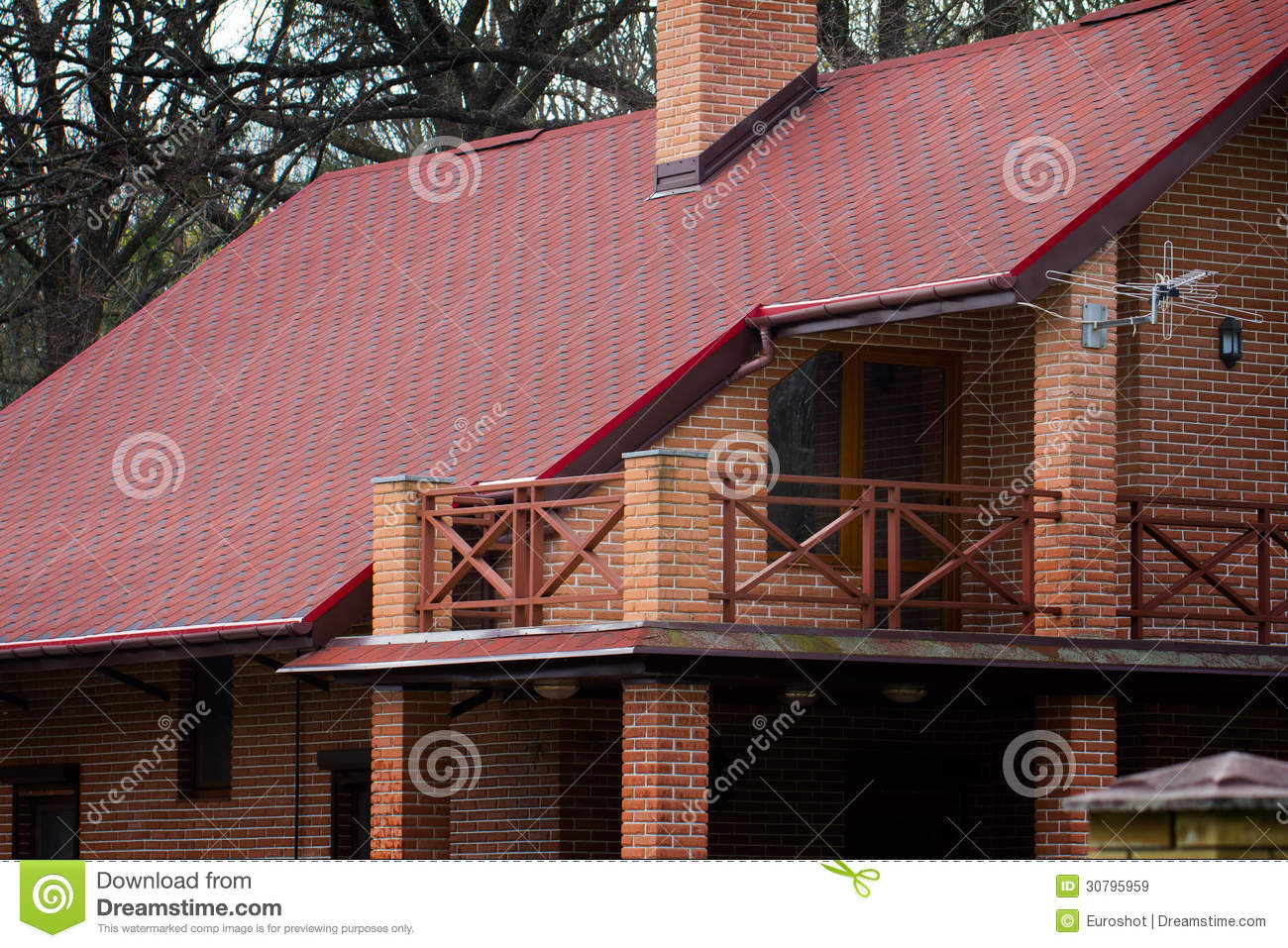 Modern Private House Of Brick With Red Roof In Spring