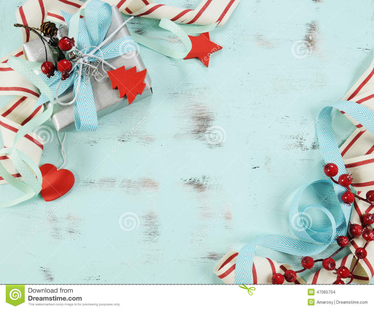 modern red and white christmas decorations on aqua blue wood background