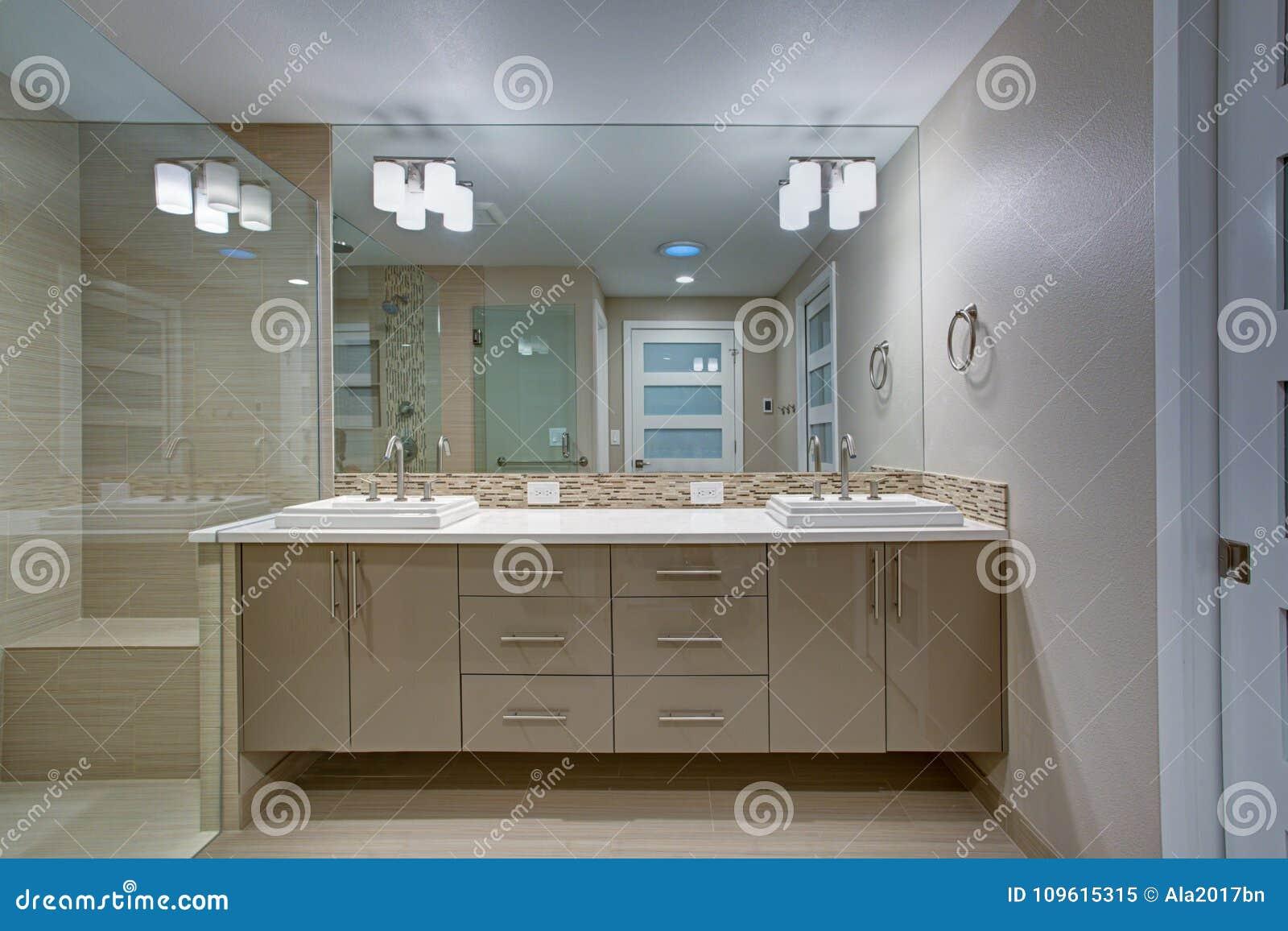 Modern refreshing bathroom with a beige dual washstand.