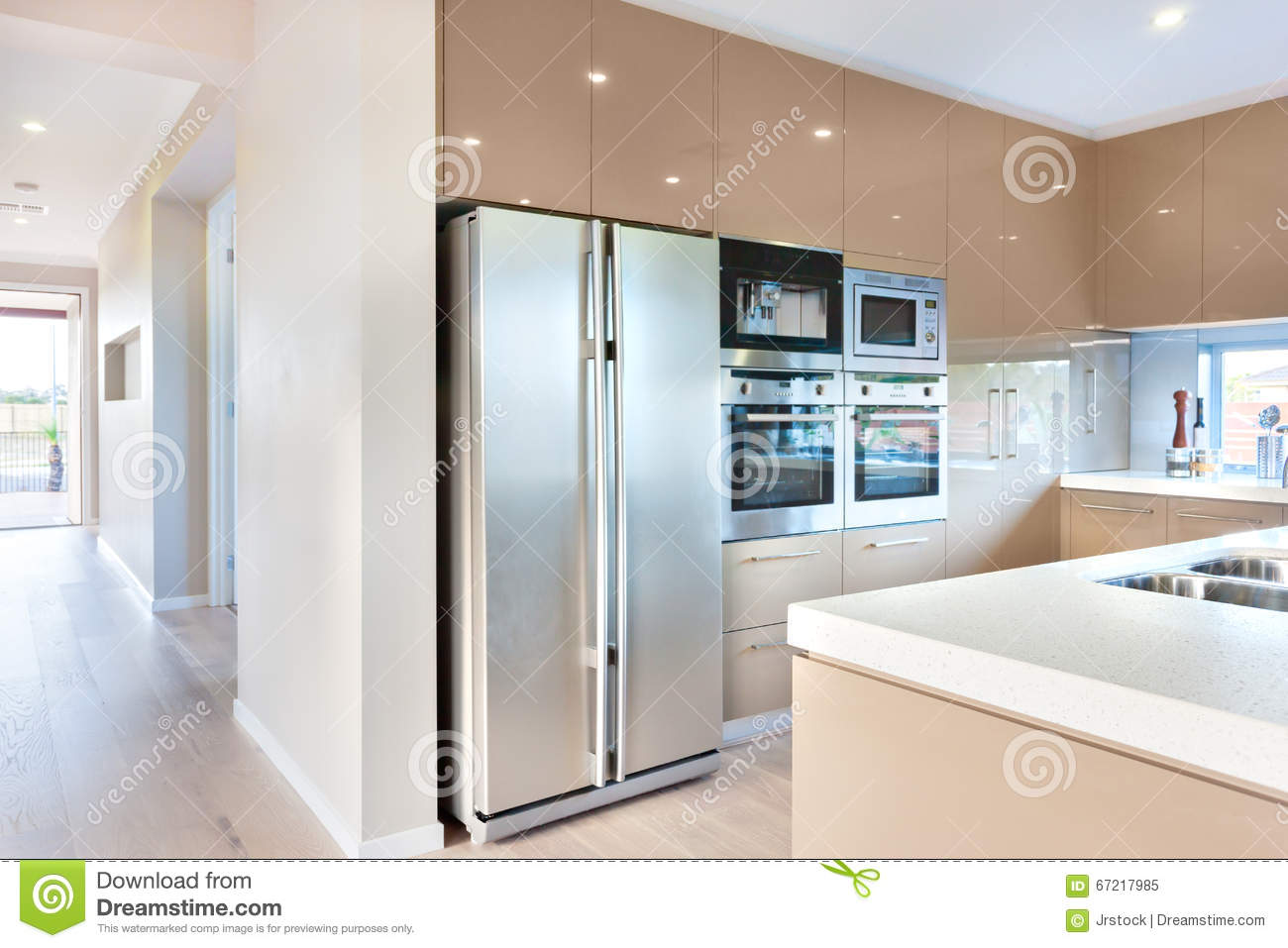 Modern Refrigerator In The Luxury Kitchen With Microwave Ovens