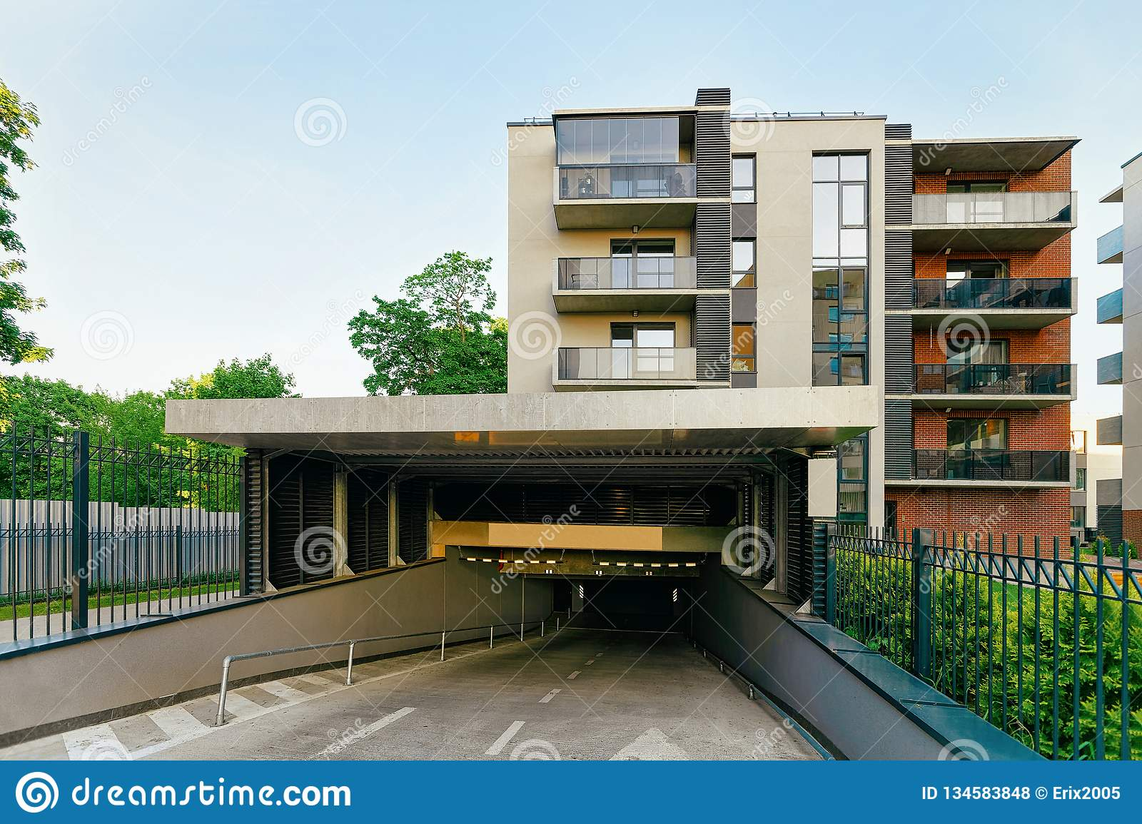 Modern Residential Apartment Building With Garage Stock ...